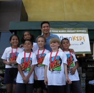 Mario Lopez poses with Saint Anne's students Saamera Jamai, Grade 5; Karla Lazaro, Grade 5; Ricky Diaz, Grade 3; Reiland Bruskotter, Grade 2; Andy Diaz, Grade 3 and Jack Evans, Grade 2. Each ran more than 100 miles this school year under the Marathon Kids 26.2 Mile Challenge. PHOTO BY KATHERINE DELAGARZA