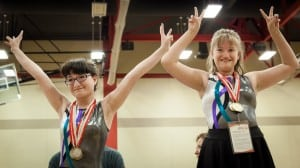 Special Olympics gymnasts celebrate on the medal stand. PHOTO BY CORY HANSEN