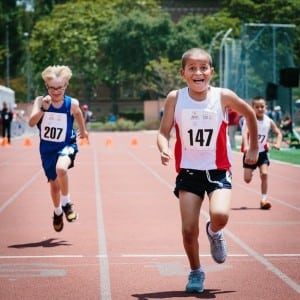 Special Olympics track athletes run with joy, regardless of how they finish. PHOTO BY CORY HANSEN