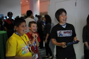 Shigeru Miyamoto playing Mario Maker (working title) at Nintendo's Kids Corner. Photo provided by Nintendo of America.