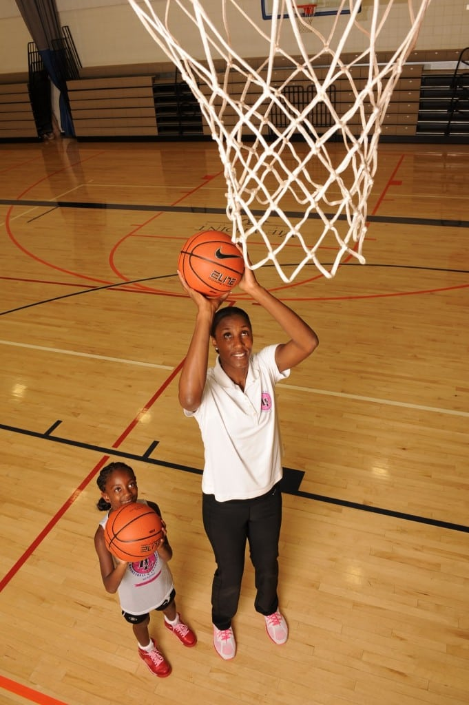 WNBA star and Olympic gold medalist Lisa Leslie and daughter Lauren take a practice shot. PHOTO BY JUAN OCAMPO