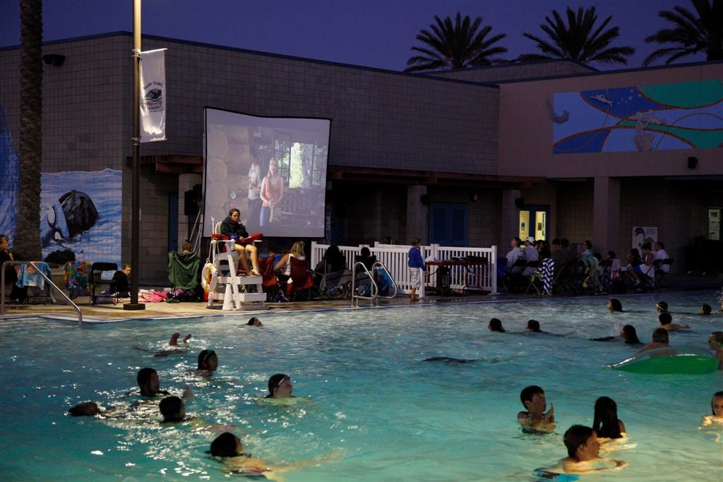 Santa Clarita Aquatic Center's Dive-In Movie series lets families jump in the pool or lounge poolside to view films. PHOTO COURTESY THE CITY OF SANTA CLARITA