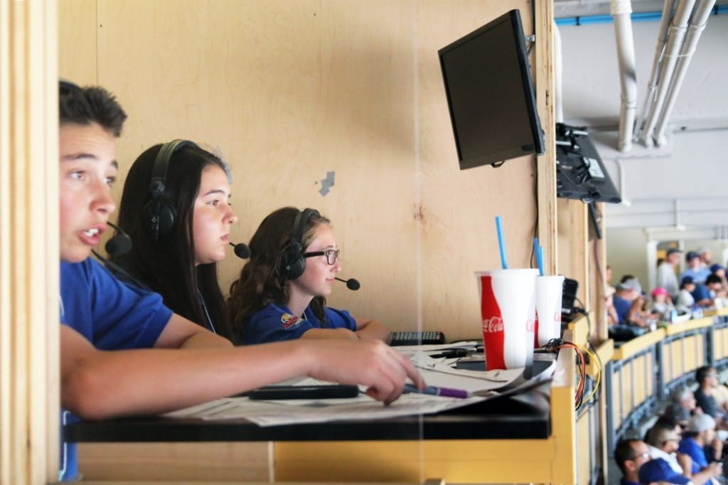 Jr. Dodger Broadcasters Max Ferregur, left, Skyler Rivera and Sarah Pino call a game at Dodger Stadium.