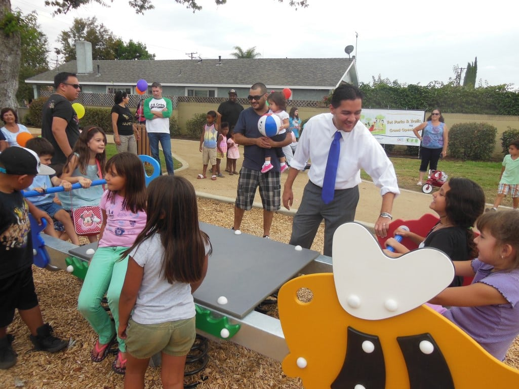 Downey Mayor Fernando Vasquez plays with kids at the grand opening of Brookshire Park. PHOTO COURTESY CITY OF DOWNEY