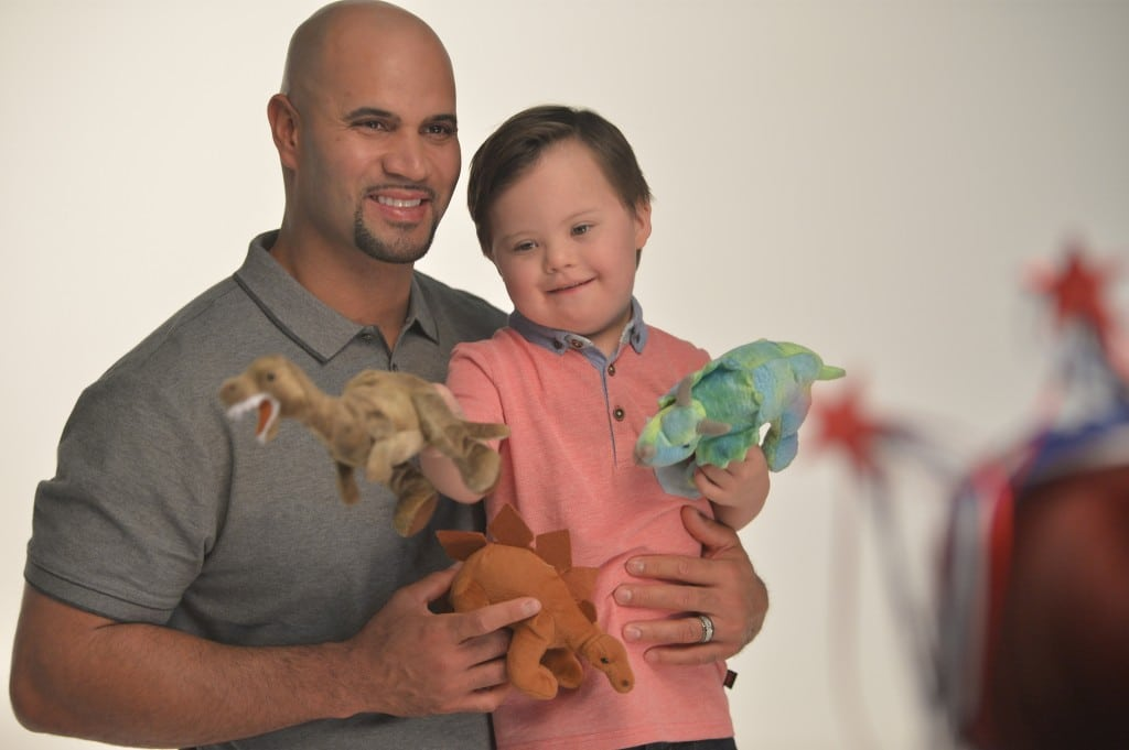 Baseball great Albert Pujols, father of five, poses with Cameron Withers, age 5, for the cover of the TY Guide for Differently-Abled Kids. PHOTO COURTESY TOYS R US