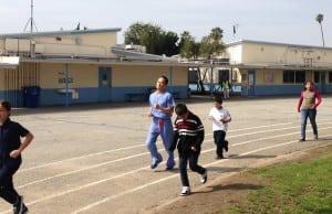 Nishi exercising with the kids at Sunrise Elementary. PHOTO COURTESY KHALILI CENTER