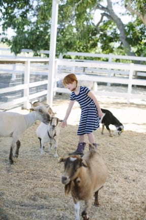 L.A. Parent October cover model Stella Hopton meets new friends at Danny's Farm. PHOTO BY TANYA ALEXIS