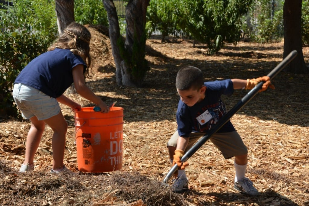Kimberly Schwarz's children help plant a community garden during a Jewish Federation Day of Good Deeds event. PHOTO COURTESY KIMBERLY SCHWARZ
