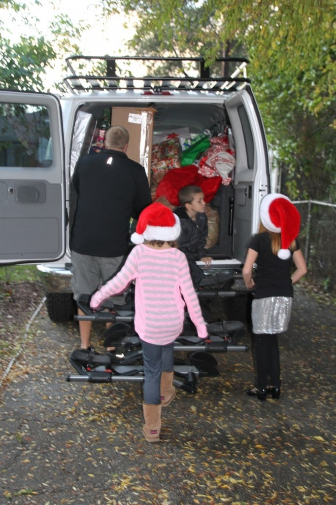 The Watters family delivers Christmas gifts to a Los Angles family with a child who has recurring brain cancer. PHOTO COURTESY THE WATTERS FAMILY
