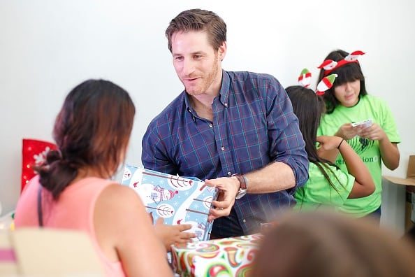 Actor Sam Jaeger of Parenthood handed out toys to families.