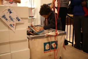 Kids can learn about the joys of reading and giving by gathering books for Milk + Bookies. PHOTO COURTESY MILK + BOOKIES