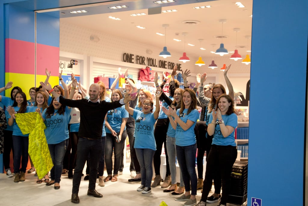 CEO and co-founder, Ido Leffler is pictured after the ribbon cutting with the Yoobi Santa Anita store team. Photo courtesy Yoobi.