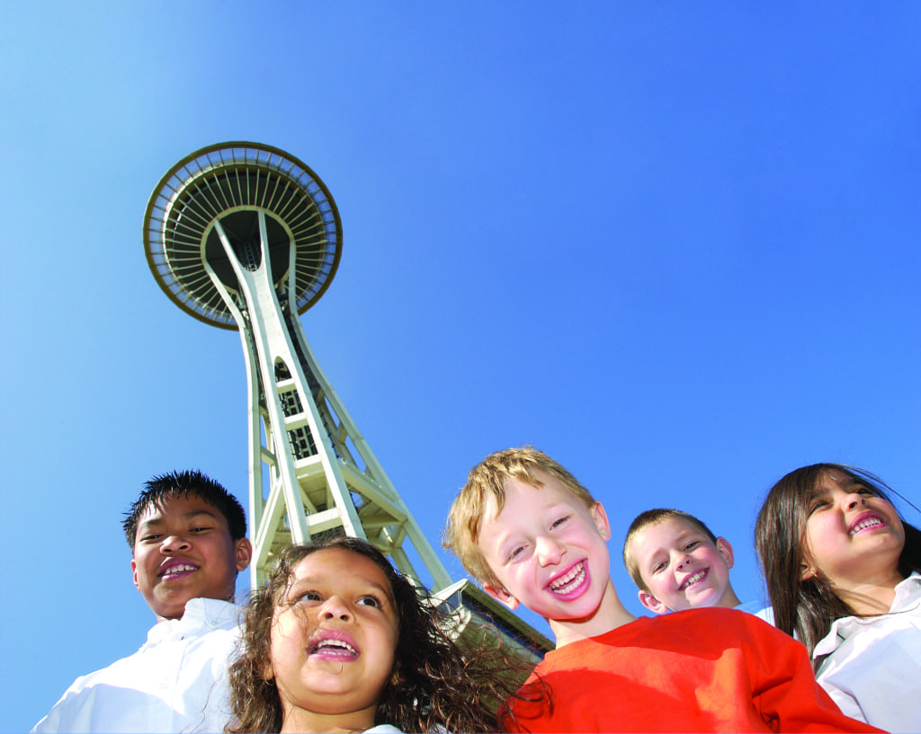 family travel space needle