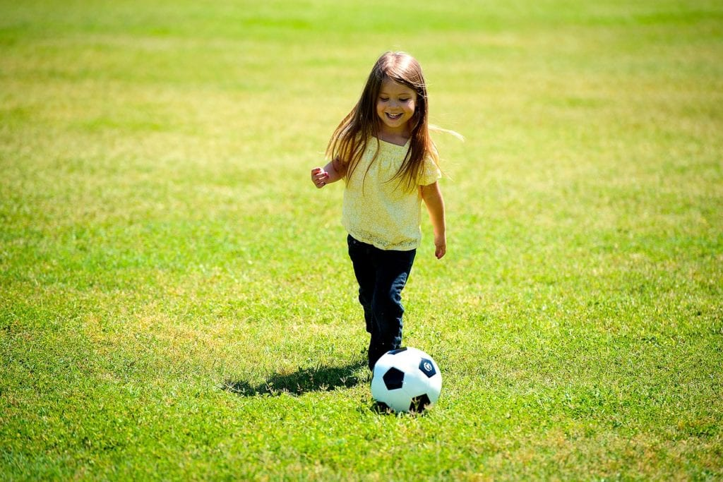 girl playing soccer childhood passion