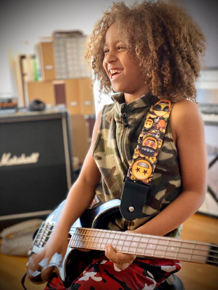 kid taking virtual music lesson