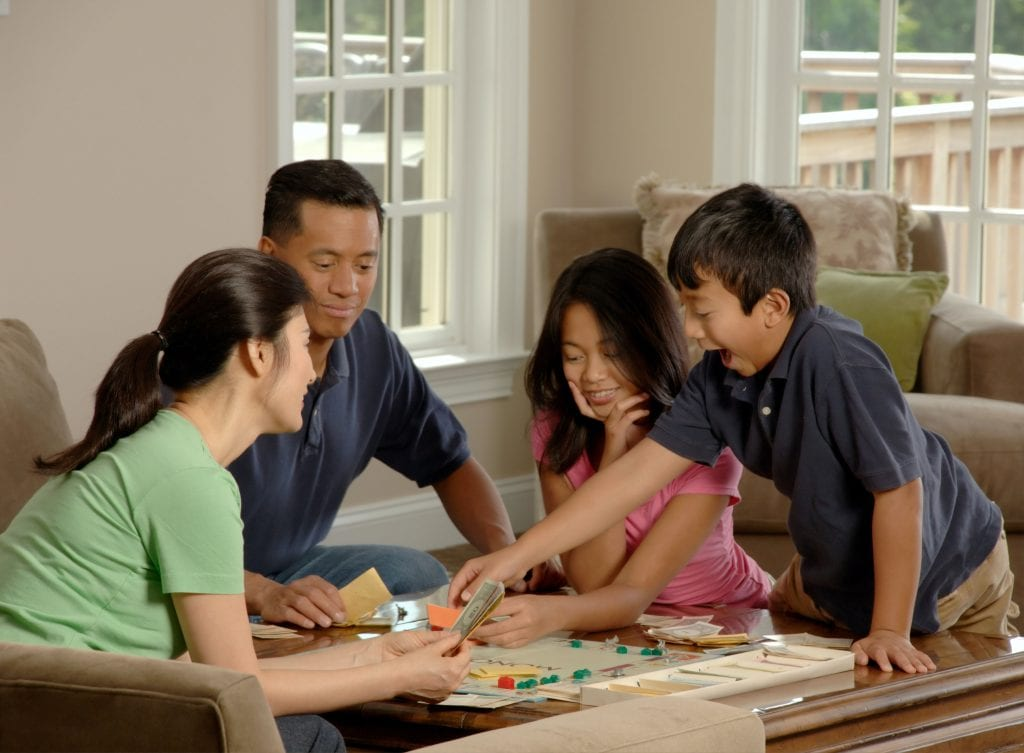 Family at play with a board game