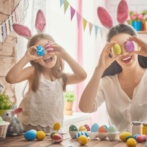 Mom and daughter with Easter bunny ears and eggs